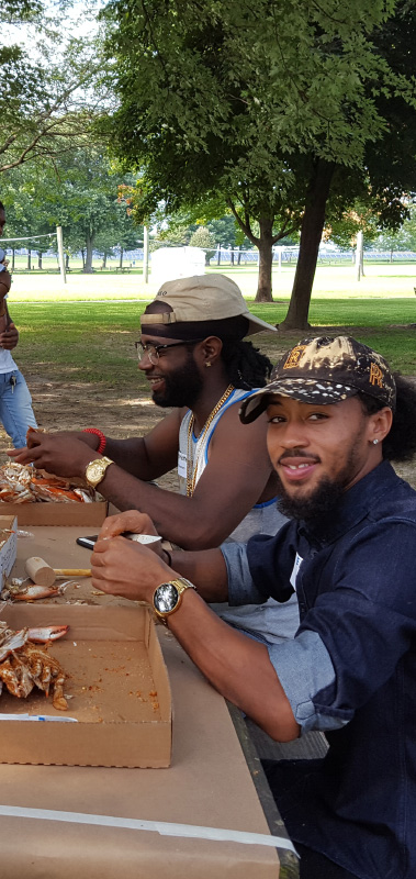 Enjoying Crabs at the Annual Company Picnic